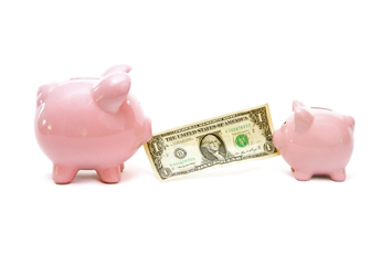 two piggy banks exchanging money