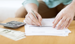 person keeping track of monthly expenses