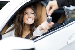 girl receiving keys to new car